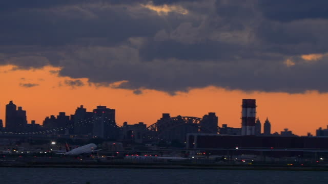 slow motion of delta plane taking off in laguardia airport in new york city - queens new york city stock videos & royalty-free footage