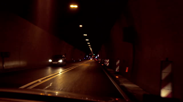 Slow motion of driving by night through tunnel