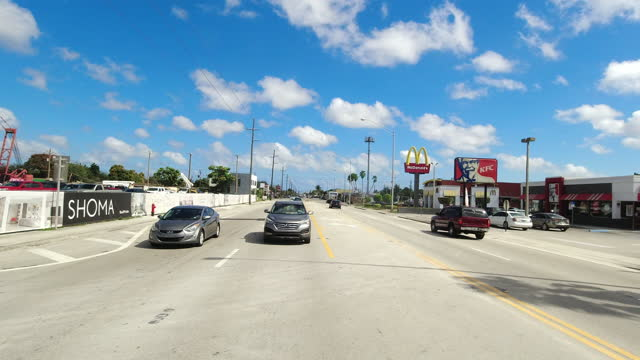 slow motion of driving past mcdonald's and kfc in miami, florida, usa amid the global coronavirus pandemic. - dramatic sky stock videos & royalty-free footage