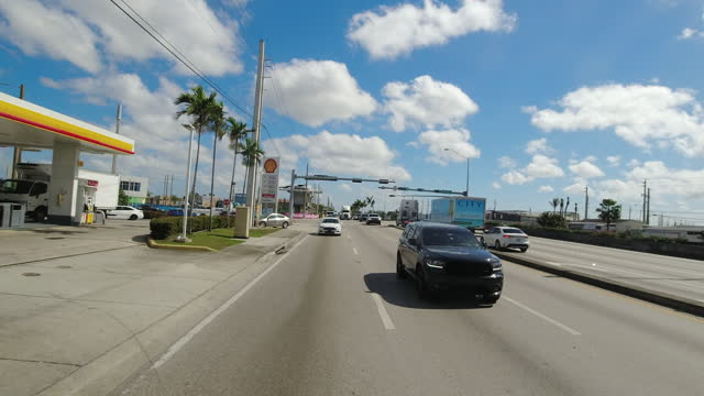 slow motion of driving past shell gas station in miami, florida, usa amid the global coronavirus pandemic. - dramatic sky stock videos & royalty-free footage