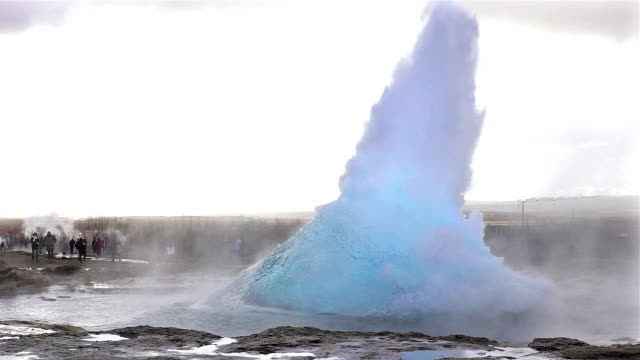 slow motion of eruption of strokkur geyser in iceland - geyser stock videos and b-roll footage