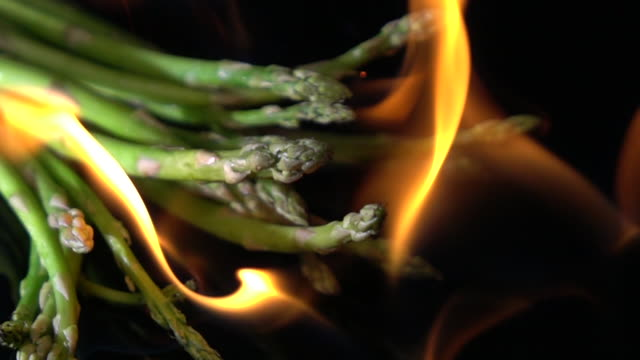 slow motion of fire burning asparagus - asparagus stock videos & royalty-free footage