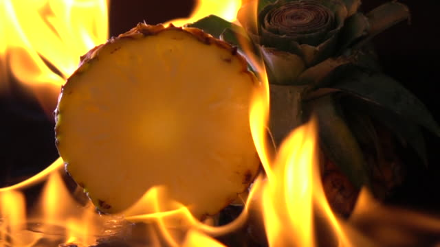 slow motion of fire burning pineapple - pineapple stock videos & royalty-free footage