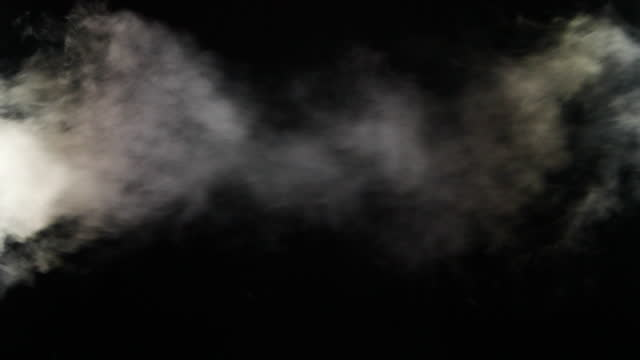 slow motion of fog, steam, smoke clouds over black background - track imprint stock videos & royalty-free footage