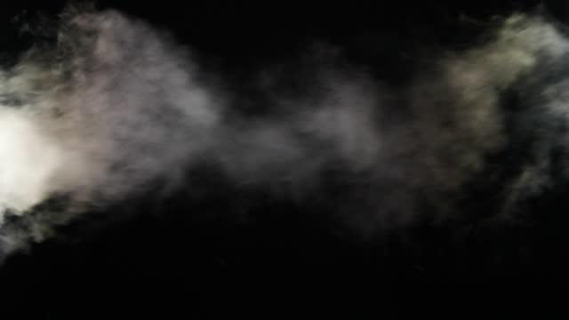 stockvideo's en b-roll-footage met langzame motie van mist, stoom, rookwolken over zwarte achtergrond - spoor vorm
