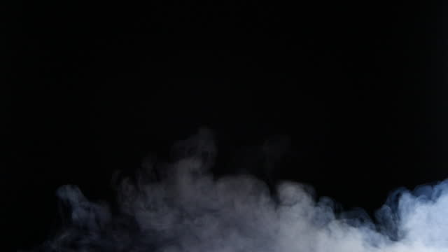 slow motion of fog, steam, smoke clouds over black background - design element stock videos & royalty-free footage