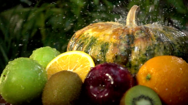 Slow motion of Fresh apples with water splash