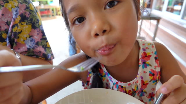 slow motion of girl eat noodle soup - shiitake stock videos & royalty-free footage