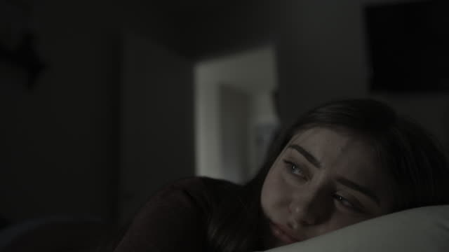 slow motion of girl in bedroom crying at approaching father holding belt / springville, utah, united states - angst stock-videos und b-roll-filmmaterial