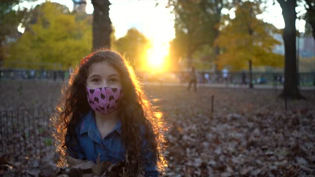 slow motion of girl throwing leaves - one baby girl only stock videos & royalty-free footage