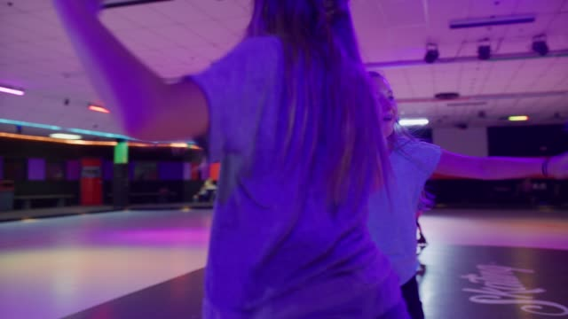 stockvideo's en b-roll-footage met slow motion of girls dancing and singing in circle at roller skating rink / orem, utah, united states - driekwartlengte