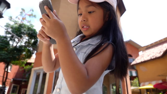 slow motion of girls using her smartphone - attitude stock videos & royalty-free footage