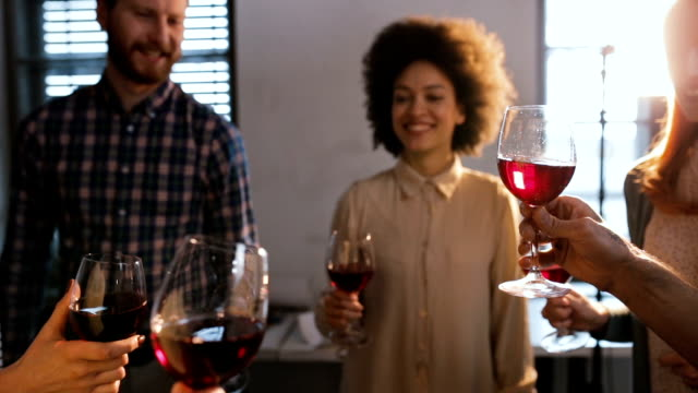 slow motion of group of people toasting with wine. - large group of people stock videos & royalty-free footage