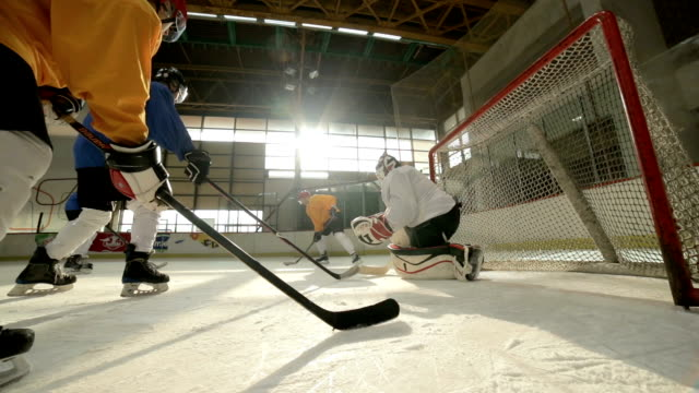 Slow motion of ice hockey players in action at hockey arena.