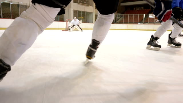 slow motion of ice hockey players in action during a match in ice hockey rink. - turno sportivo video stock e b–roll