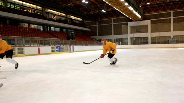 Slow motion of ice hockey players in action during sports match at the arena.