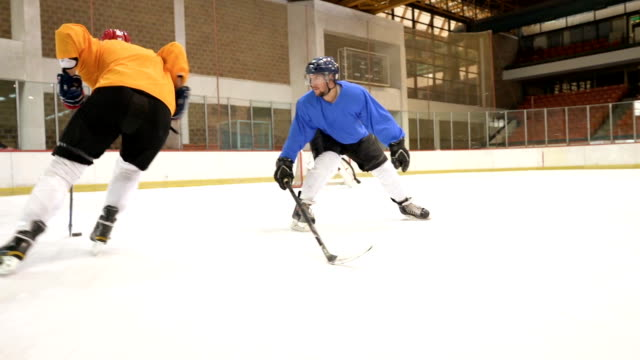 slow motion of ice hockey players in action on a sports match in ice hockey rink. - tackling stock videos and b-roll footage