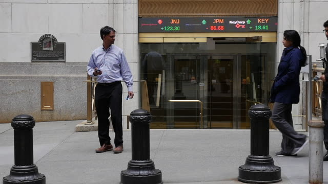 Slow motion of Indian businessmen walking at New York stock exchange