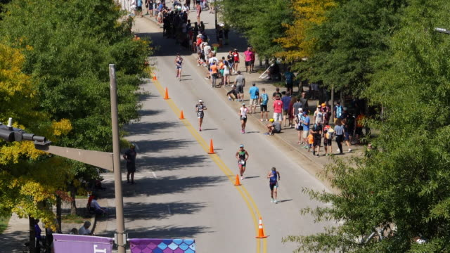 slow motion of ironman 70.3 women running in chattanooga, tn - chattanooga stock videos and b-roll footage