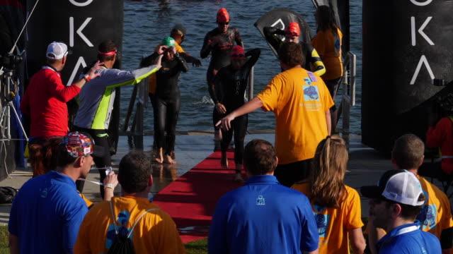 vídeos y material grabado en eventos de stock de slow motion of ironman 70.3  women swimming race in chattanooga, tn - triatleta