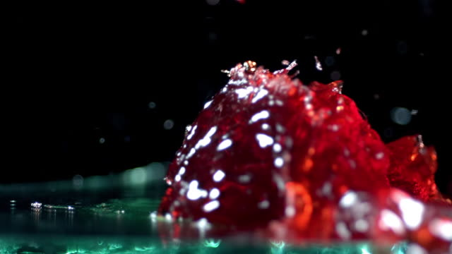 slow motion of jello being shot by airgun. - gelatin stock videos and b-roll footage