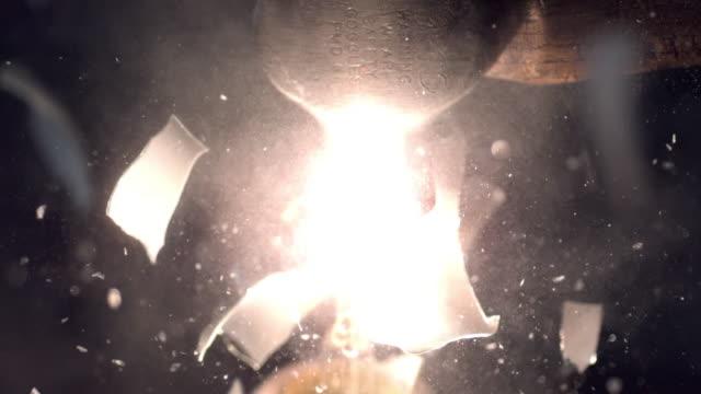 slow motion of light bulb shattering from hammer smashing it. - オレム点の映像素材/bロール
