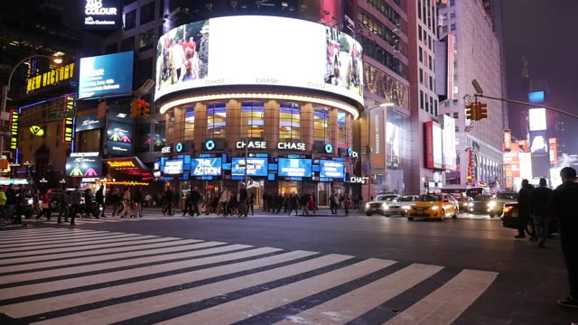 slow motion of limousine driving in new york city at night - electronic billboard stock videos and b-roll footage