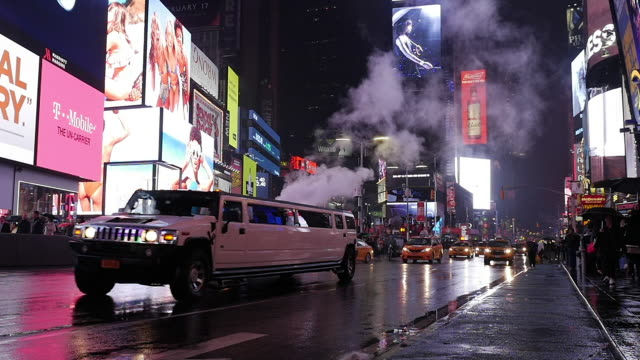 slow motion of limousine driving raining day in new york city manhattan times square - limousine stock videos & royalty-free footage