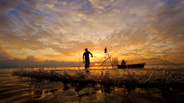 Slow motion of Local lifestyles of fisherman working in the morning sunrise.