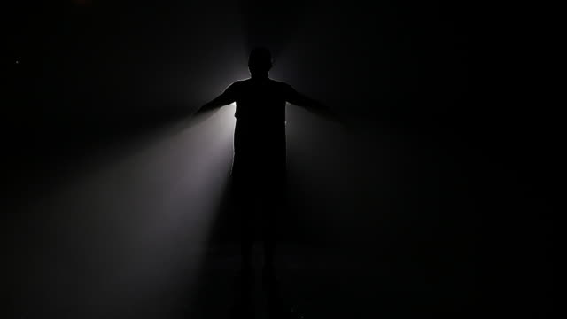 Slow motion of man embracing light