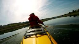 Slow motion of man paddling the kayak