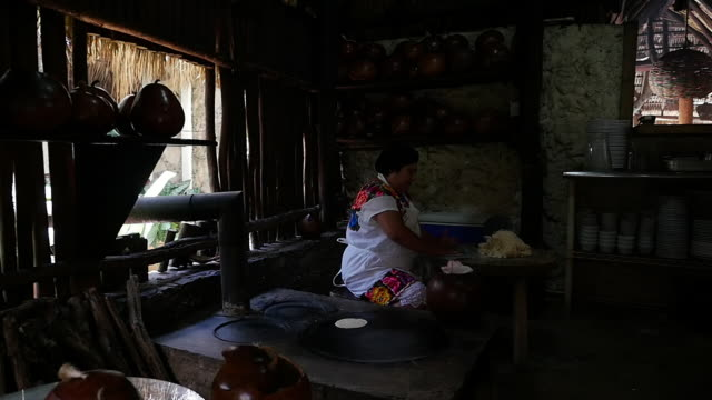 slow motion of mexican woman is preparing traditional cake no - maya kultur stock-videos und b-roll-filmmaterial