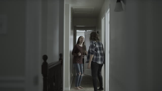 vídeos de stock e filmes b-roll de slow motion of mother and defiant daughter arguing then girl slamming bedroom door / springville, utah, united states - brigar