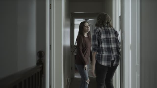 vídeos y material grabado en eventos de stock de slow motion of mother and defiant daughter arguing then girl slamming bedroom door / springville, utah, united states - lucha conceptos