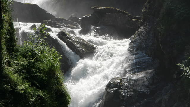 slow motion of mountain waterfalls and sunlight - spirituality stock videos & royalty-free footage