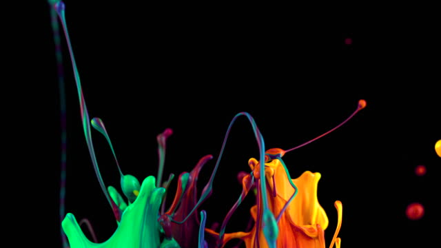 slow motion of multi colored paints bouncing and splashing on black background - はずむ点の映像素材/bロール