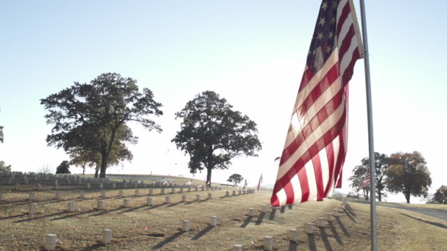slow motion of national cemetery and flag under the sunlight - chattanooga stock videos and b-roll footage