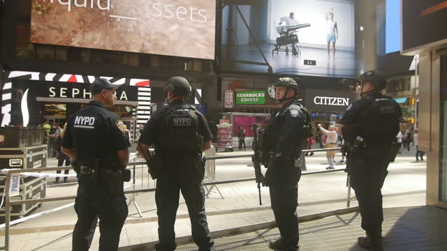 Slow motion of New York City police swat team being deployed in Times Square