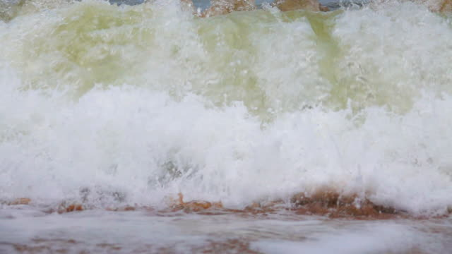 slow motion of ocean wave on sand tropical beach of thailand. - afterlife stock videos and b-roll footage