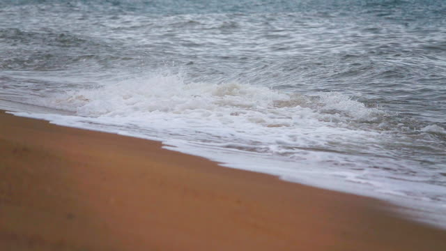 slow motion of ocean wave on sand - bugtiger stock videos and b-roll footage