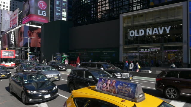 slow motion of old navy billboad and traffic in times square - theatre district stock videos & royalty-free footage