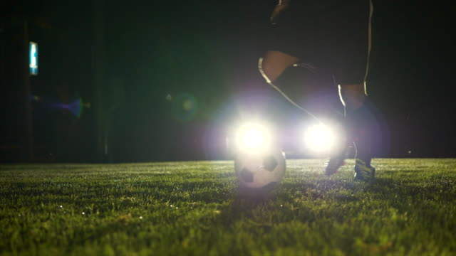 Slow Motion of One Soccer Player Playing with Ball. Sports Training Competition Background