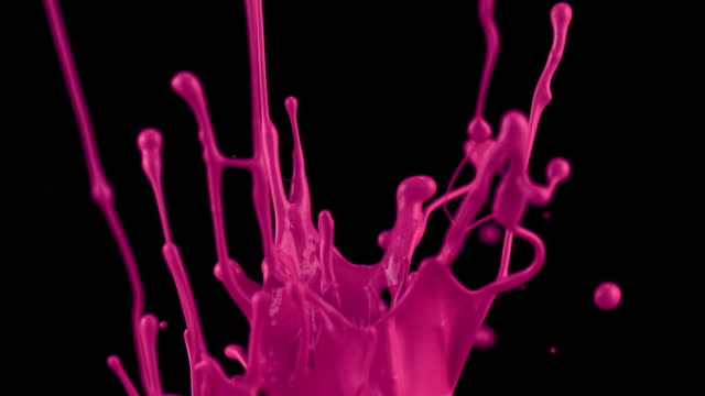 slow motion of paint bouncing and making splash, - liquid stock-videos und b-roll-filmmaterial