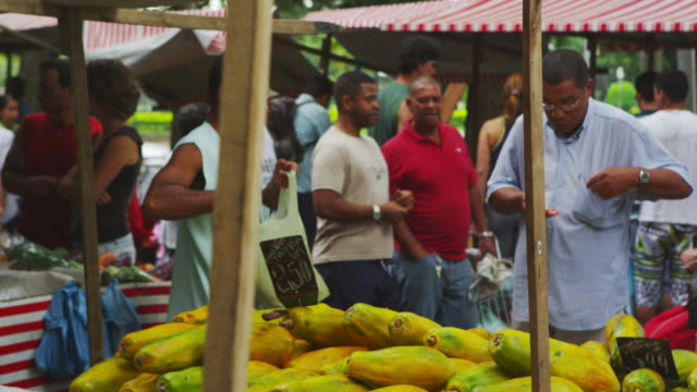 vídeos de stock, filmes e b-roll de rio de janeiro, brazil - june 23: slow motion of people at market on june 23, 2013 in rio, brazil - 2013