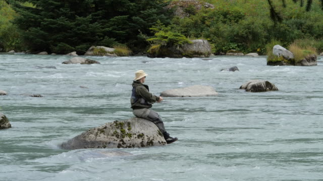 slow motion of people fishing in haines alaska usa - zen like stock videos & royalty-free footage