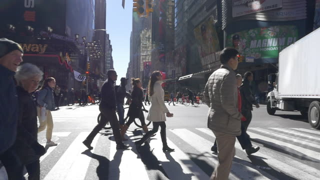 slow motion of people walking and crossing street in nyc - foot stock videos & royalty-free footage