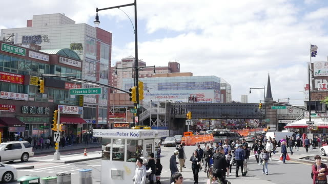 slow motion of people walking and shopping in flushing, queens, new york - queens stock-videos und b-roll-filmmaterial