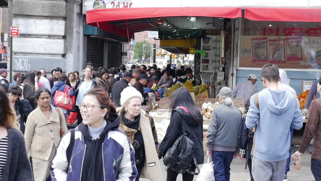 slow motion of people walking and shopping in flushing, queens, new york - flushing queens stock videos and b-roll footage