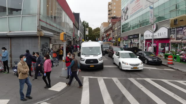 slow motion of people walking in flushing - queens new york city stock videos & royalty-free footage