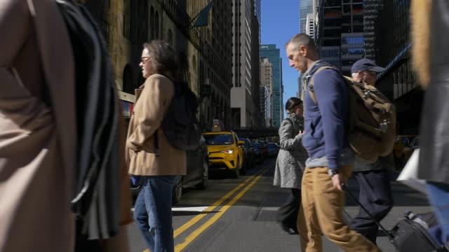 slow motion of people walking in nyc - street stock videos & royalty-free footage